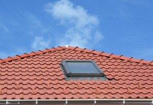 Skylight in a tile roof on a clear day