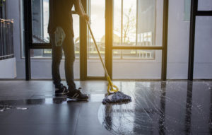 a cleaner mops a floor