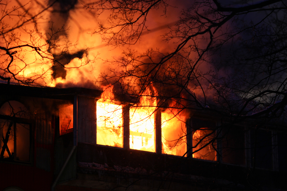 a home burns in the night